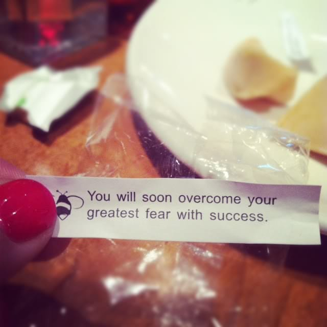 """A fortune cookie paper with the words """"You will soon overcome your greatest fear with success."""""""