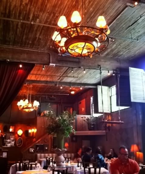 Photo of the interior of a restaurant with rustic decor
