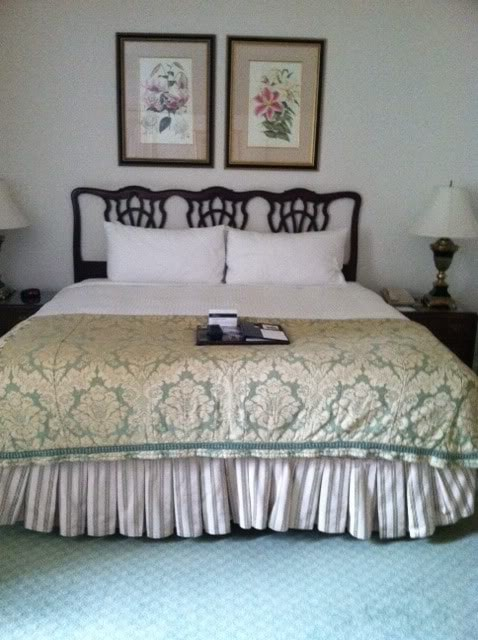 Photo of a bed at a hotel with country decor