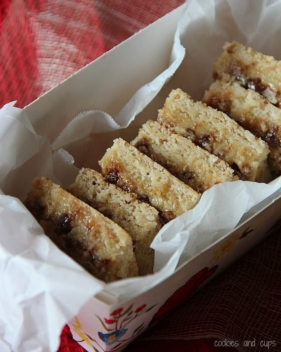 A stack of cake mix toffee bars in a parchment-lined box