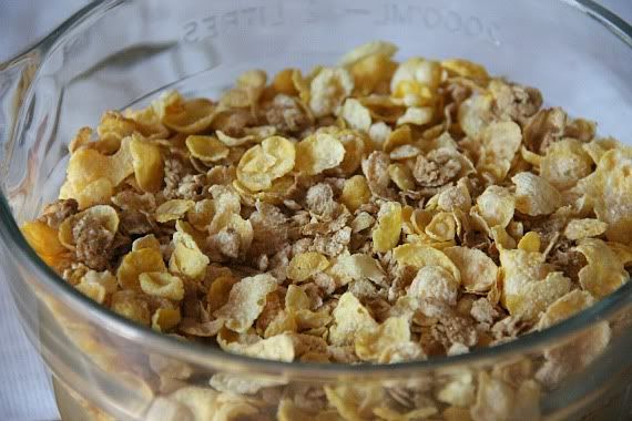 Honey Bunches of Oats cereal in a mixing bowl