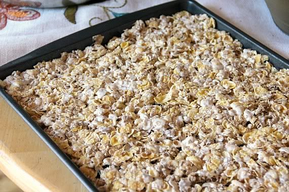 Cereal and marshmallow mixture pressed into a jelly roll pan