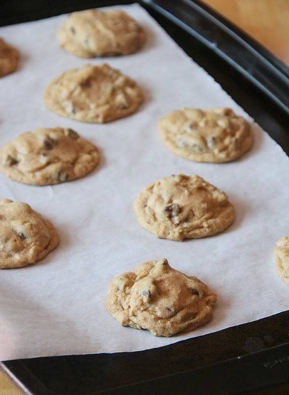 Chocolate chip cookies on a parchment-lined baking sheet