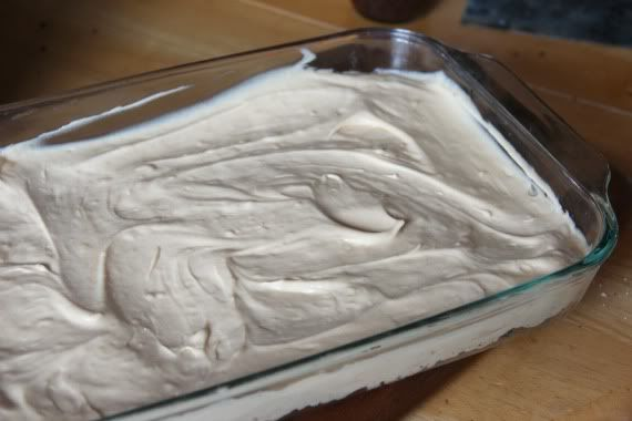 Peanut butter cream cheese frosting layer spread in a 9x13 pan