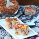Plate with two pieces of fruity pebble fudge