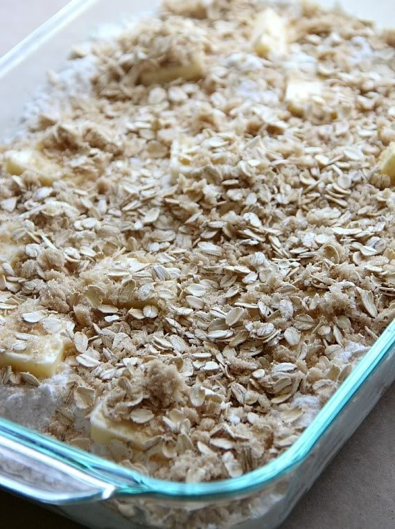 Apple mixture with oat crumbly topping in a baking dish