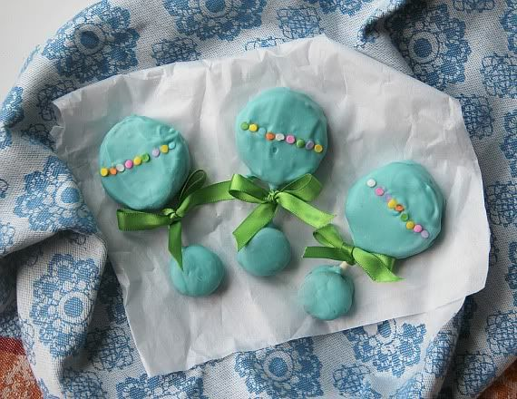 Teal frosted baby rattle cookies