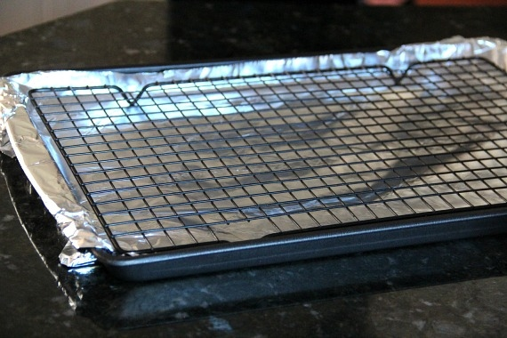 A baking sheet line with foil with a cooling rack on it