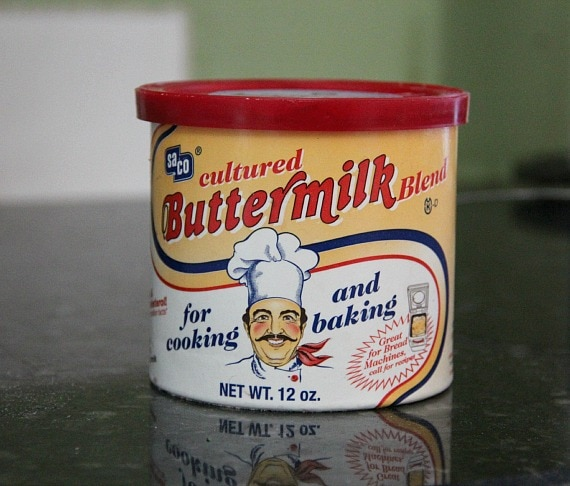 A yellow and white can of powdered cultured buttermilk powder