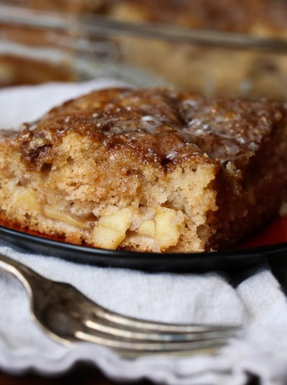 Slice of apple fritter cake with fork