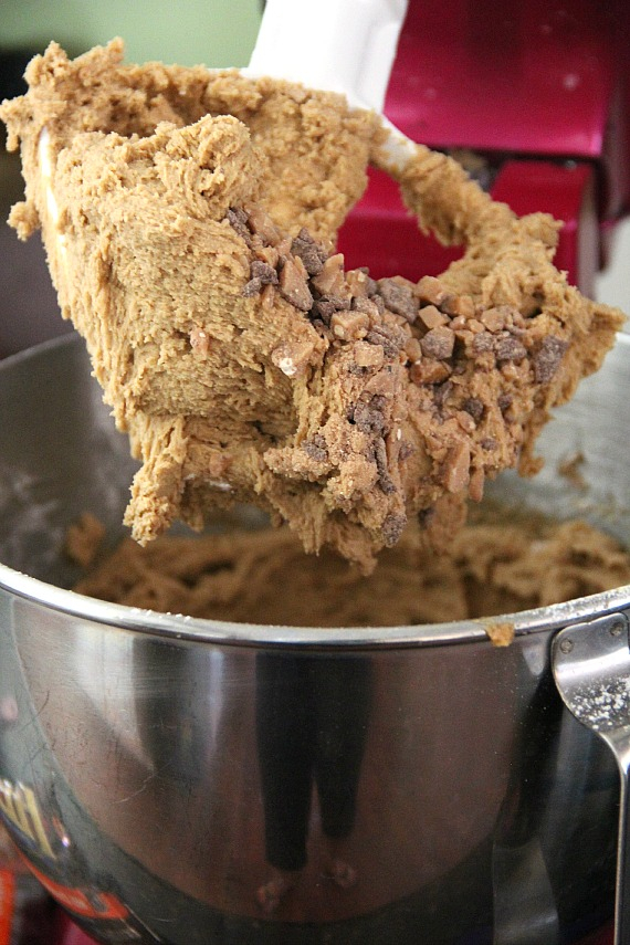 Batter with toffee bits in a stand mixer bowl