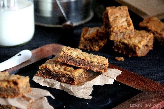 Stacked brown sugar toffee bars on parchment paper