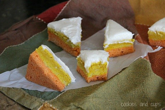 Triangles of Candy Corn Sugar Cookie bars on parchment paper