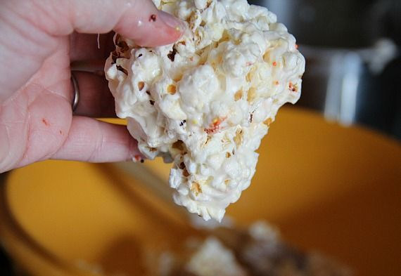 Popcorn marshmallow mixture being formed into a ball