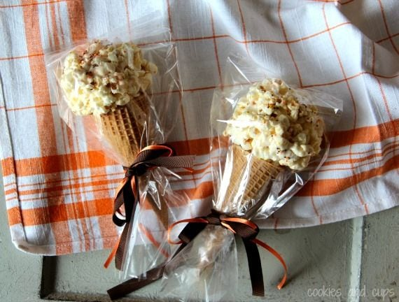 Two popcorn ball ice cream cones packaged in plastic with a ribbon