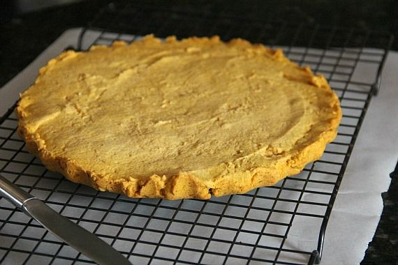 A round pumpkin shortbread on a cooling rack