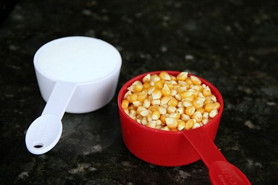 Popcorn kernels and sugar in measuring cups