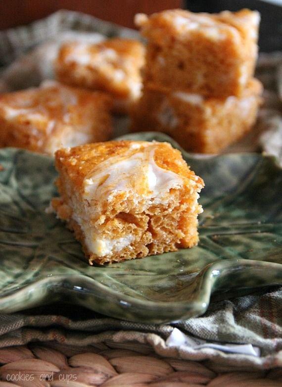 Pumpkin cream cheese swirl bars on a plate
