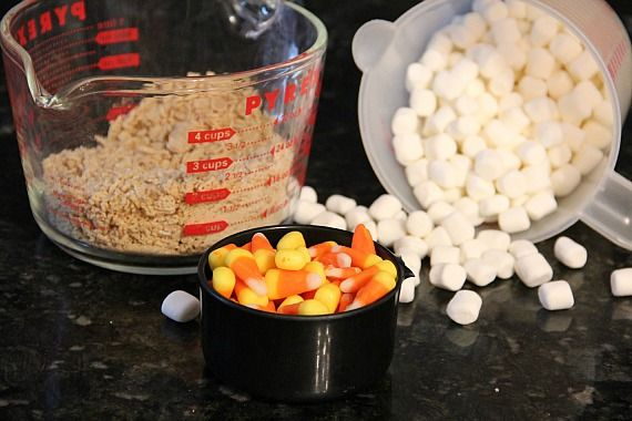 A bowl of chex cereal, candy corn, and mini marshmallows