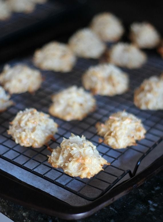 Baked coconut macaroons on a cooling rack
