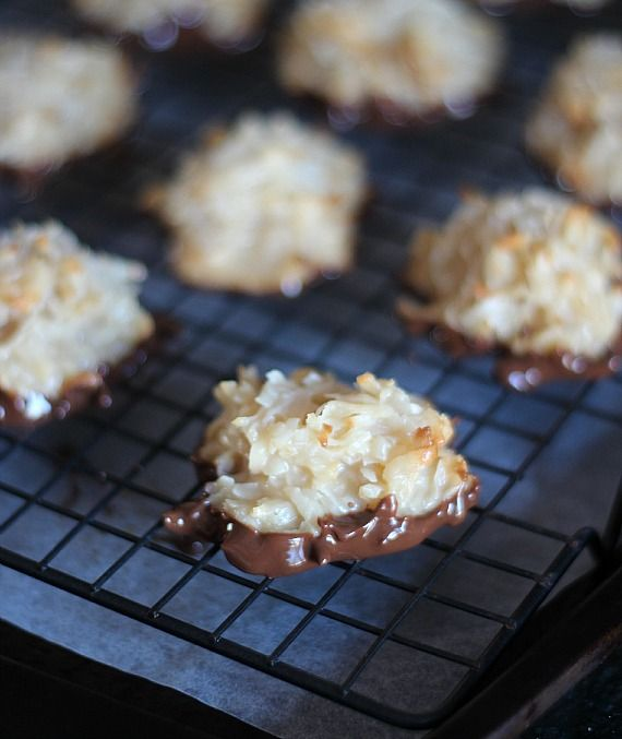 Chocolate dipped coconut macaroons on a cooling rack