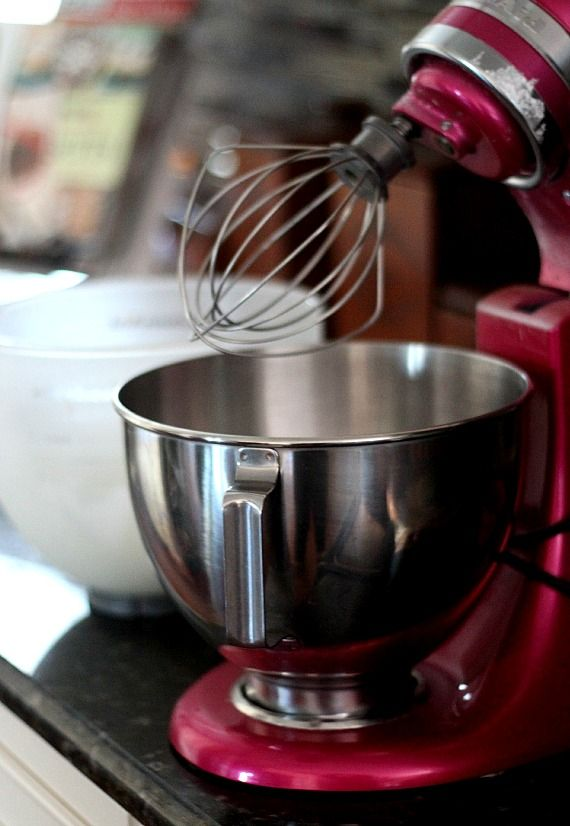 Red KitchenAid stand mixer with whisk attachment
