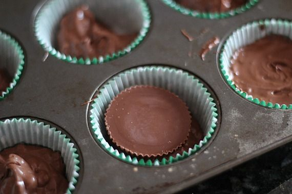 Image of Crock Pot Candy Batter in a Muffin Tin with a Reese's Cup