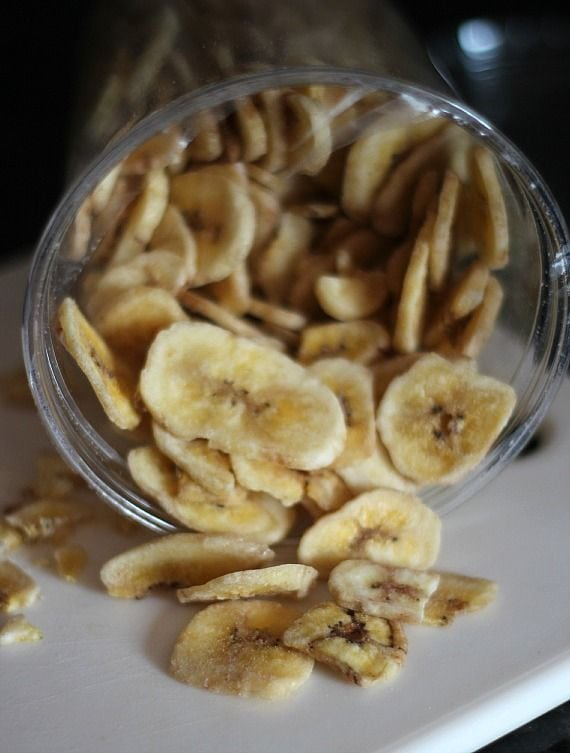 Top view of sliced banana chips in a jar