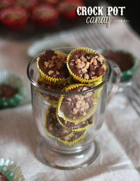 Cup of crock pot chocolate candies in wrappers