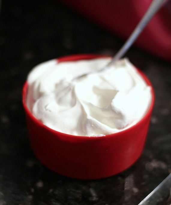 A measuring cup of whipped cream