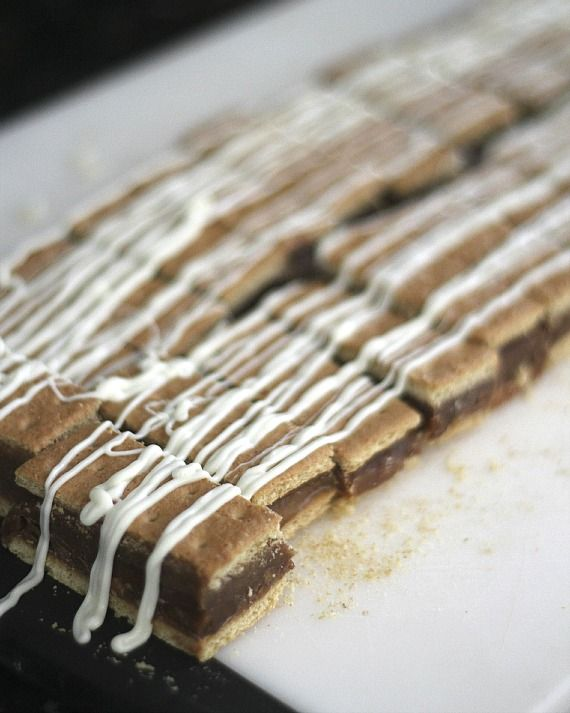 Graham Cracker Bars drizzled with icing on a cutting board