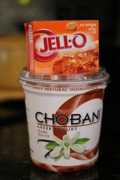 A box of orange Jell-o on top of a quart of Chobani greek yogurt