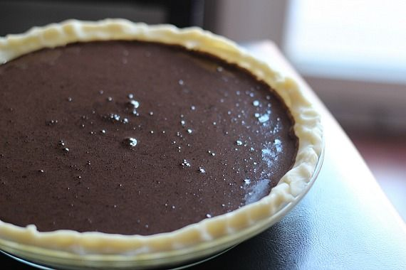 An unbaked pie with chocolate filling