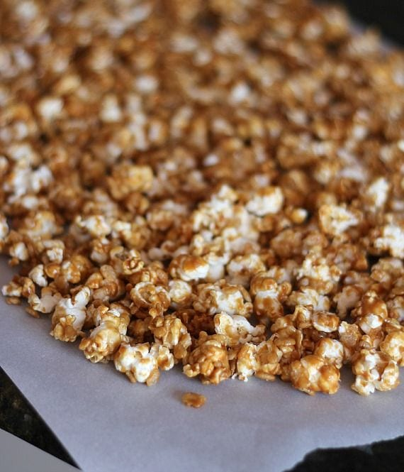 Peanut butter caramel corn on parchment paper after baking