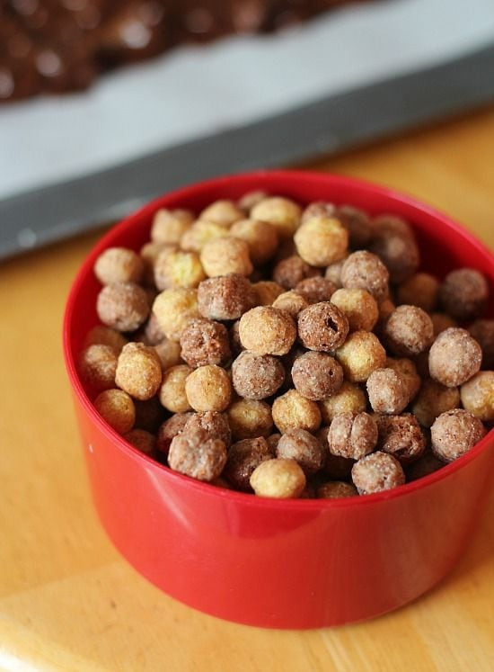 Chocolate peanut butter cereal puffs in a measuring cup
