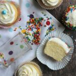 Image of vanilla cupcakes with sprinkles and buttercream frosting