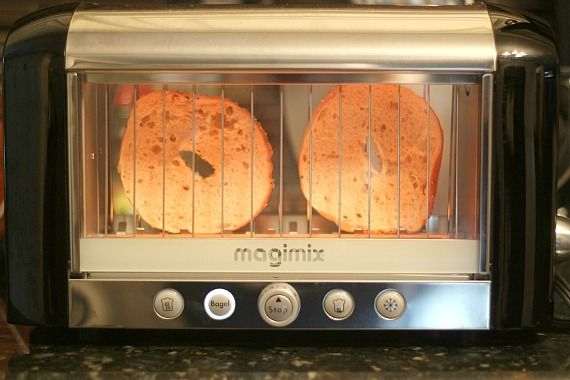 Two bagel halves in a Magimix View toaster