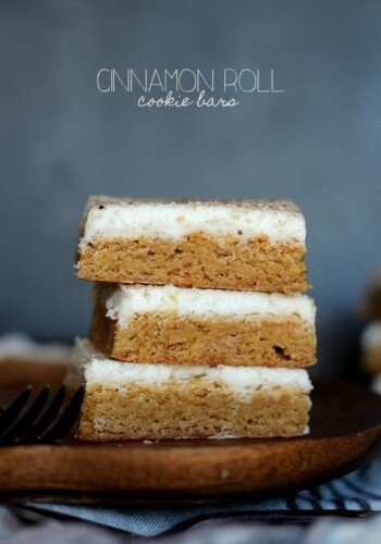 Cinnamon Roll Cookie Bars ~ Starts with a Cake Mix and is topped with delicious cream cheese frosting! www.cookiesandcups.com