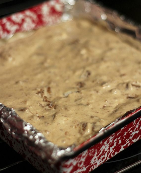 Oatmeal cream pie cheesecake batter spread in a foil-lined square pan
