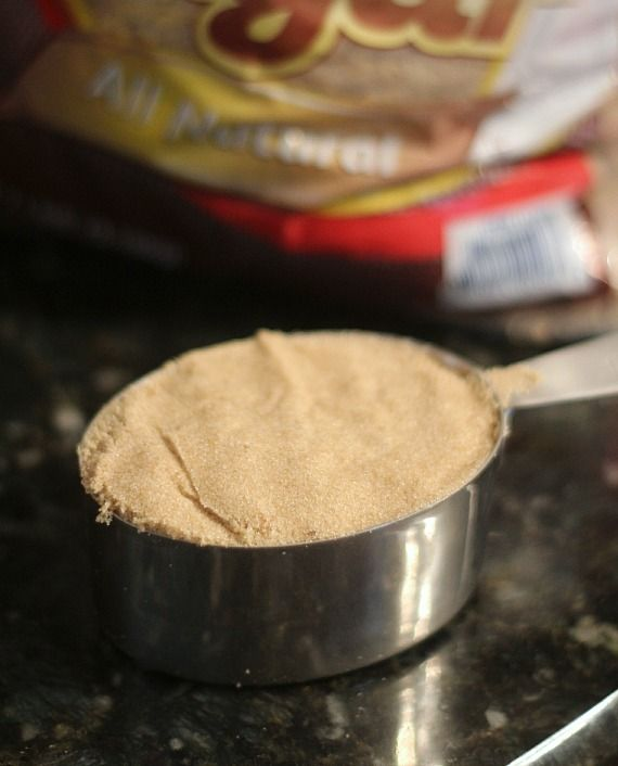 Packed brown sugar in a measuring cup