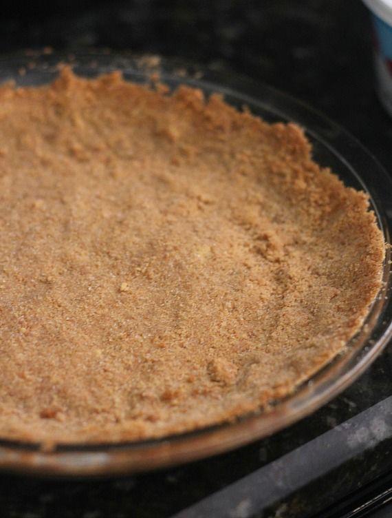 A graham cracker crust in a pie plate