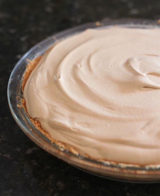 Creamy root beer pie in a graham cracker crust-lined pie plate