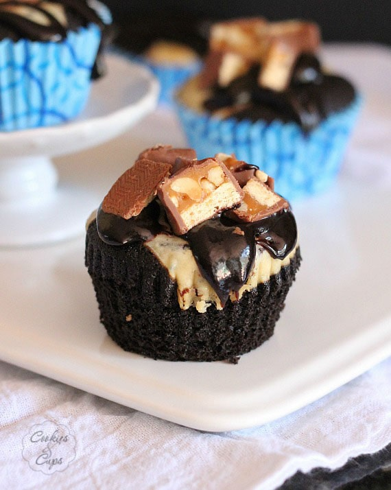 Devil's Food Snickers Cheesecake Cupcakes | www.cookiesandcups.com | #cupcakes #recipes #snickers #cheesecake #devilsfood