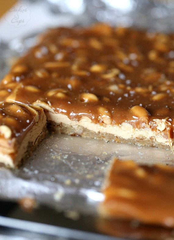 Salty Caramel Peanut Bars ~ These easy bars have a brown sugar pretzel crust layered with peanut butter nougat and topped with salty peanuts and caramel!
