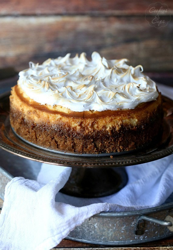 Image of a Lemon Meringue Cheesecake on a Cake Stande