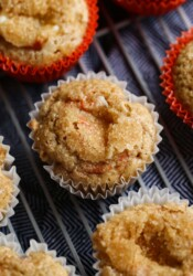 Carrot Cake Muffins on a cooling rack topped with crunchy sugar