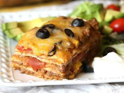 Burrito Lasagna ~ layeres of Tex-Mex flavors all in one dinner! Great for making ahead and freezing
