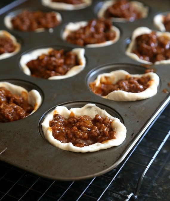 Unbaked Sloppy Joe muffin cups in a muffin tin