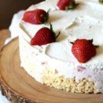 Krispie Treat strawberry ice cream pie on a wooden board