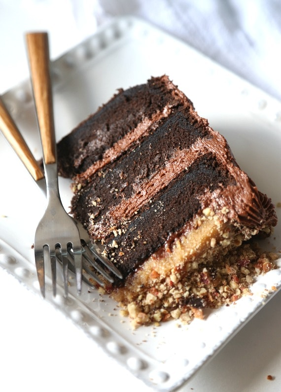Bacon Pecan Crumble Chocolate Cake. This cake is EPIC! Super soft chocolate cake, amazing frosting and topped with a thick layer of caramel and salty bacon pecan crumble!! CRAZY GOOD!!